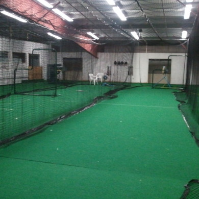 Baseball batting cage on track – can be slid off arena, in Hampton, NH.