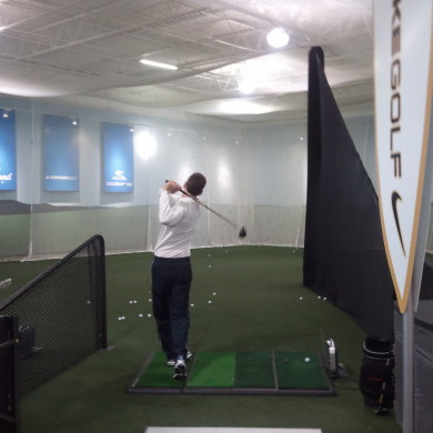 An indoor golf range.