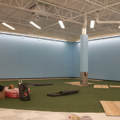 A before photo of an indoor golf range.