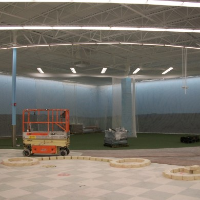 An after photo of an indoor golf range.
