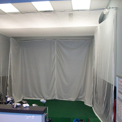 Golf studio with heavy duty curtains.