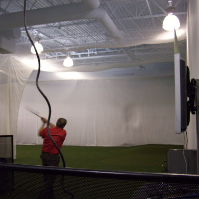A golf ball hitting a heavy duty curtain.
