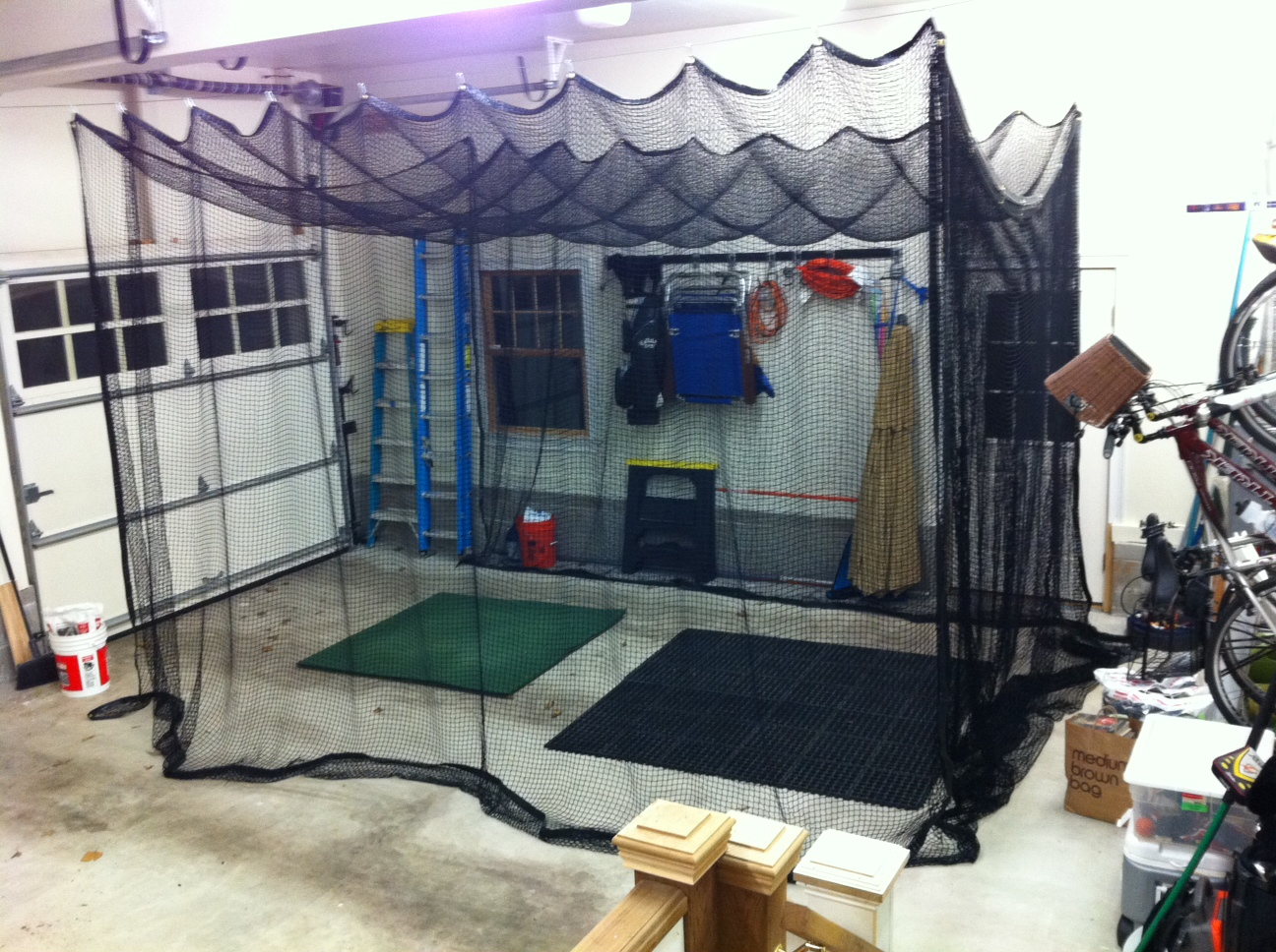 Custom, Retractable Open Golf Net In Home Garage.