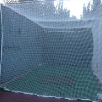 Golf practice net on tennis court, Pasadena, CA.