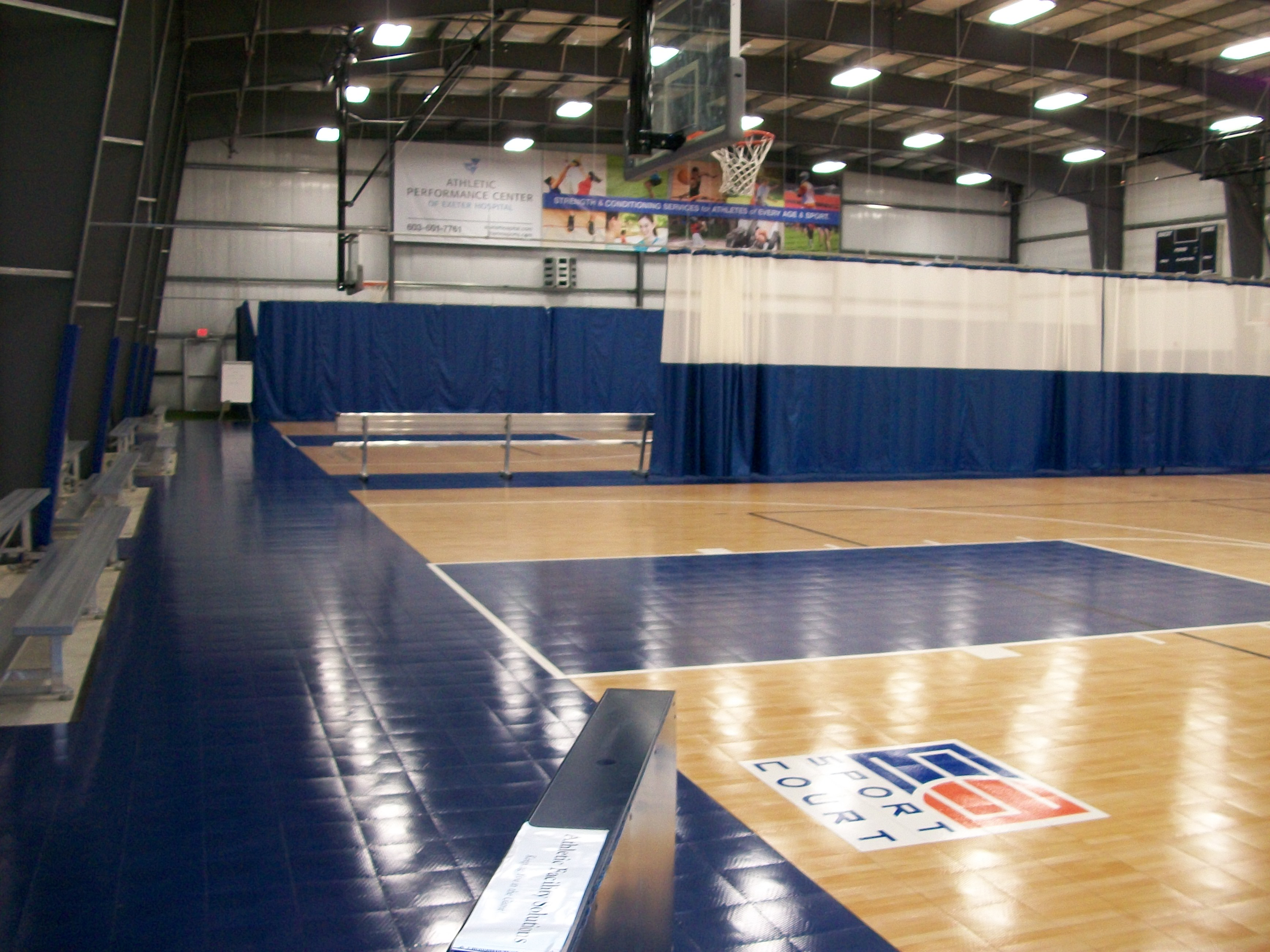 Vinyl Curtains In Back And Mesh On Track With Sport Court Basketball